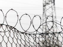 Cerca con alambre de púas Foto de archivo libre de regalías