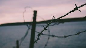 Cerca de alambre de Barb en la playa Imágenes de archivo libres de regalías