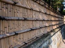 Cerca de bambú alrededor de la casa Imágenes de archivo libres de regalías