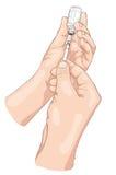 Cerca de la insulina de una ampolla en jeringuilla. Imágenes de archivo libres de regalías