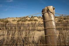 Cerca de la protección en una playa de Donana Fotos de archivo libres de regalías