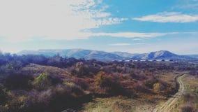 Cerca de las montañas Foto de archivo libre de regalías