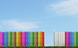Cerca de madeira colorida com porta aberta Fotografia de Stock