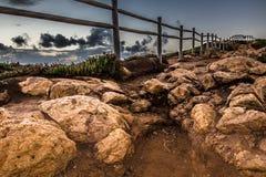 Cerca de madeira na borda de Europa Por do sol matizado Imagem de Stock Royalty Free