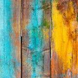 Cerca de madeira velha pintada em cores diferentes Foto de Stock Royalty Free
