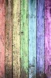 Cerca de madera pintada arco iris envejecida Imágenes de archivo libres de regalías