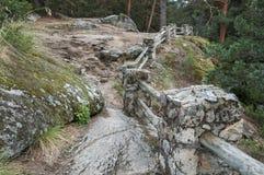Cerca de piedra y de madera Fotos de archivo libres de regalías