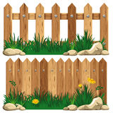 Cerca e hierba de madera