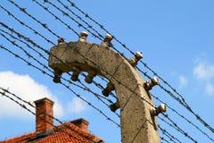 Cerca eléctrica de Auschwitz Foto de archivo libre de regalías