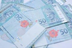 Cerca encima del billete de banco de Malasia de 50 ringgits El ringgit es la divisa nacional de Malasia foto de archivo libre de regalías
