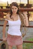 Cerca joven del corral del Cowgirl Imágenes de archivo libres de regalías