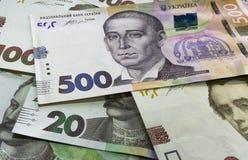 Cerca para arriba compita del dinero ucraniano 100, el grivnia 500 para el diseño y los proyectos creativos imagen de archivo libre de regalías