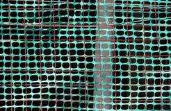 Cercado del emplazamiento de la obra con rejilla verde Fotografía de archivo libre de regalías