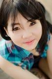 Cercare e sorriso della ragazza della Tailandia. fotografia stock libera da diritti