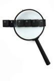 Cerchi (chiavi di tastiera) ed ingrandica il vetro Immagine Stock