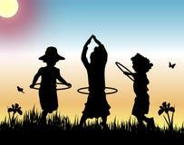 Cerchi di Hula al tramonto Fotografia Stock