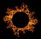 Cerchio della fiamma arancione isolato sul nero Fotografia Stock