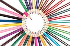 Cerchio delle matite con un puntatore Fotografie Stock Libere da Diritti