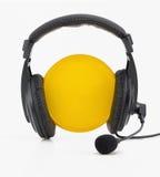 Cerchio giallo delle cuffie Fotografia Stock Libera da Diritti