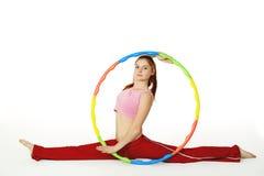 Cercle de hula de fixation d'instructeur de forme physique de femme Photographie stock