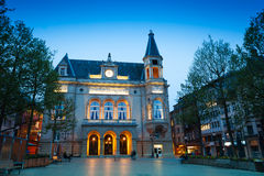 Cercle Municipal with lights at night time royalty free stock photo