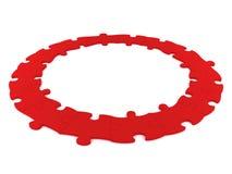 Cercle rouge de puzzle Photos libres de droits