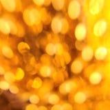 Cercles d'or de tache floue abstraite légère de fond Image stock