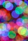 Cercles légers colorés brouillés Photos libres de droits