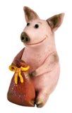 Cerdo con un bolso del dinero Foto de archivo libre de regalías