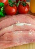 Cerdo crudo con las verduras Foto de archivo libre de regalías