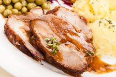 Cerdo de carne asada con la salsa Foto de archivo libre de regalías