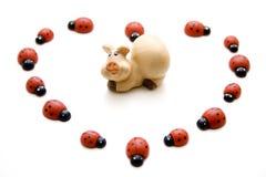 Cerdo de la suerte con el ladybug Imagenes de archivo