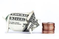 Cerdo del dinero que come monedas fotos de archivo