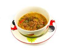 Cerdo en el curry de tierra de la crema del cacahuete-coco Imagenes de archivo