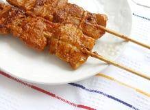 Cerdo rayado de los kebabs coreanos Imagenes de archivo