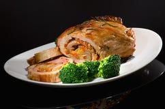 Cerdo rodado con bróculi Fotografía de archivo libre de regalías