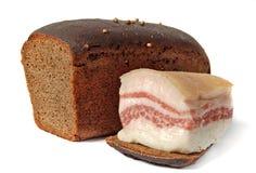 Cerdo salado gordo y el pan de centeno de Borodino Fotografía de archivo