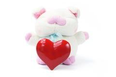 Cerdo suave del juguete con el corazón del amor Imágenes de archivo libres de regalías
