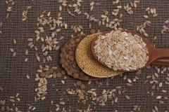 Cereais em colheres de madeira Fotografia de Stock