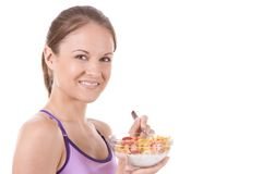 Cereal. Young woman on white background with a bowl of cereal Royalty Free Stock Photos