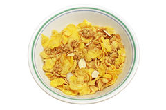 Cereal. Single serving of corn flakes and rolled oats breakfast cereal with nuts in a bowl royalty free stock photography