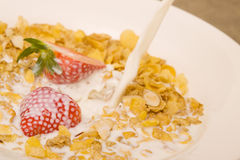 Cereal. Pouring milk into a bowl of cereal Royalty Free Stock Photo
