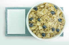 Cereal. Picture of a cereal in a bowl with a blank card next to it Stock Image