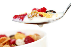 Cereal. Healthy, whole grain breakfast cereal with pieces of fresh raspberries stock photo