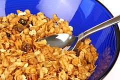 Cereal. Closeup of spoon in bowl of cereal with no milk Royalty Free Stock Photography
