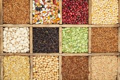 Cereal. Assorted agricultural cereal products in vintage wooden box Stock Photography