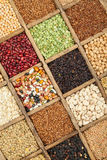 Cereal. Assorted agricultural cereal products in vintage wooden box Stock Photos