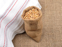 Cereal bag on jute Royalty Free Stock Photos