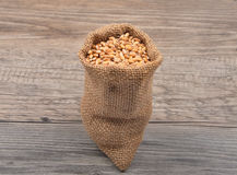 Cereal bag on wood Royalty Free Stock Photography