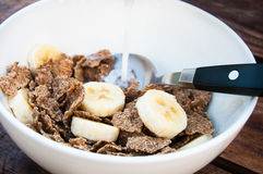 Cereal with Banana and Milk. Closeup. Morning breakfast. Healthy eating Stock Image